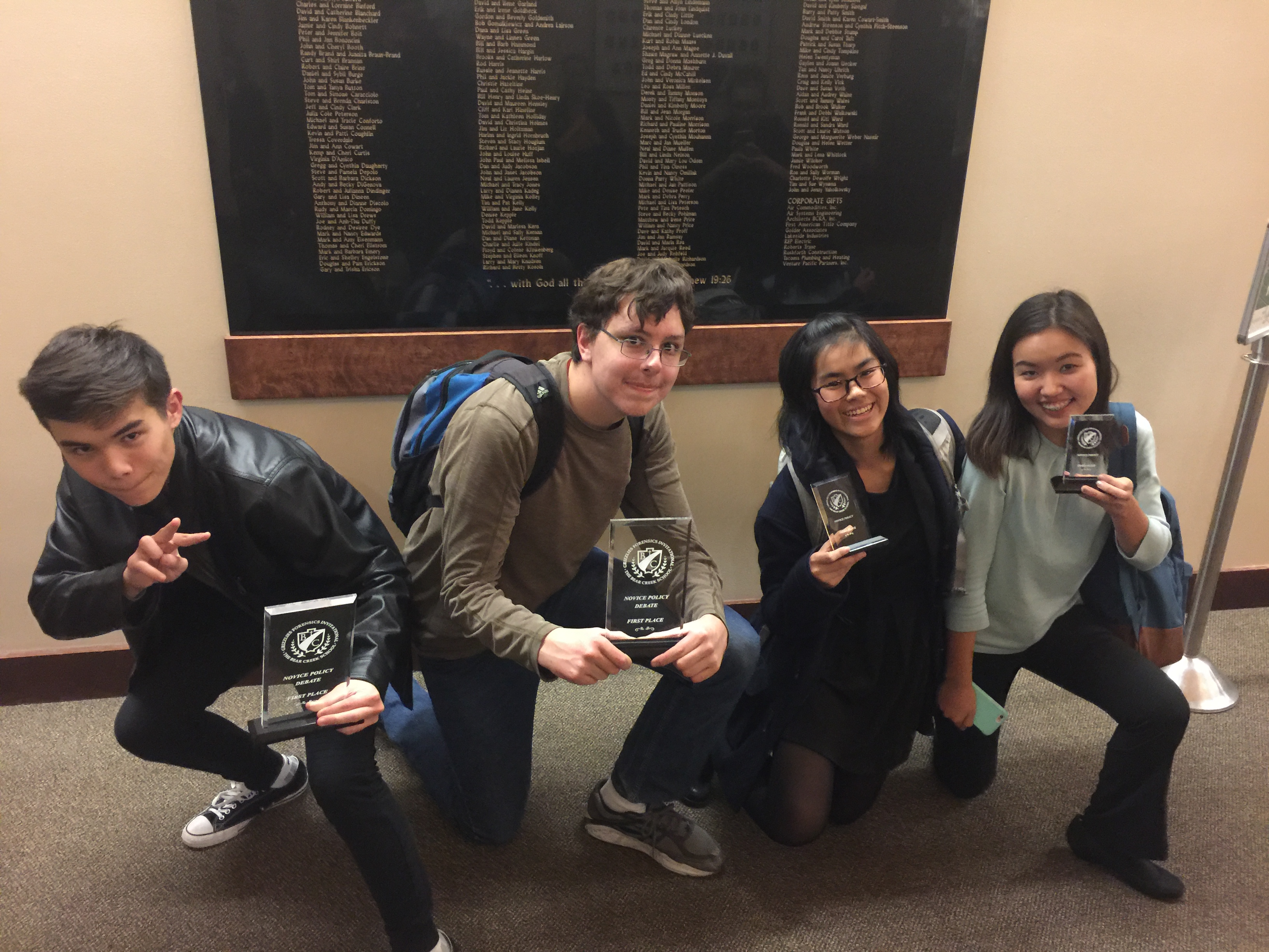 Novice debaters with their Bear Creek trophies